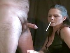 Sexy Mature Female Always Smokes Her Cigarette While Giving Blowj