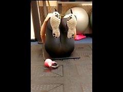 Big ass on yogapants exercising on the gym