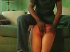 Spanking to a burning red Ass