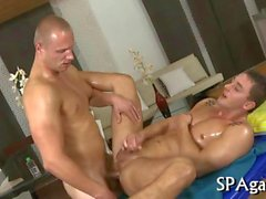 Raunchy massage session with two oiled up studs