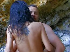 Spanish babe gets bent over on beach