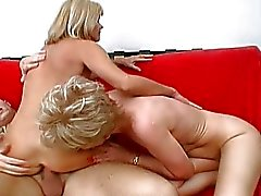 Two horny mature ladies share one lucky fucker