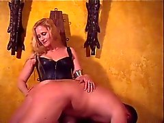 Mistress Amberle, spanking her slaves ass