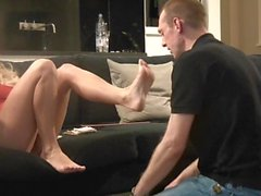 Dannii Harwood enslaves husband with her feet