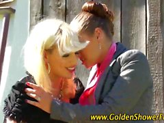 Lesbos piss and lick outdoors