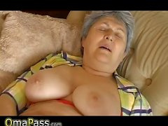 Granny with big sagging tits masturbating on the couch