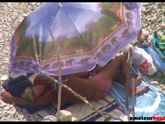 Nudist mature wife giving handjob on beach voyeur
