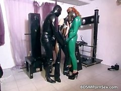 Dirty brunette babe in green latex sucks