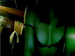 Young Italian amateur sets up her webcam and shows her tits in the dark