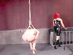 BDSM dominatrix spanks ass and loaded balls