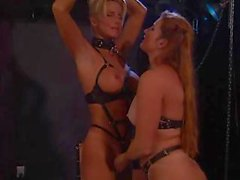 Two lesbians act out some bondage and fuck with a strapon