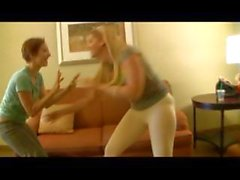 Blonde and brunette are playing a game and then start to undress