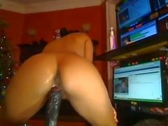 Young Latina fucks huge cum filled dildo