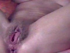 Jonees fingering and toying her hairy pussy