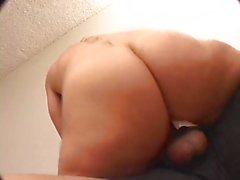 Blonde MILF in thong squeezes her big nice tits on couch