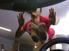 Asian hottie rubs tits against car window