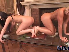 Two lovely honeys lick each other is feet