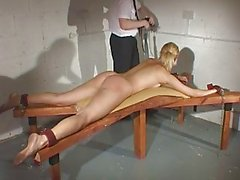Nude flogging and strapping