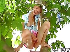 busty blackhair pissing o the tree