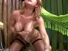 Blonde shemale bounces her huge tits in messy whipped cream