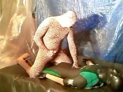 Leopard dominates and humps surfer in shorty wetsuit