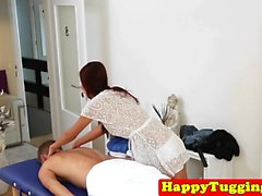 Redhead asian masseuse tugging her client