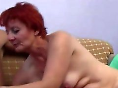 Redhead Granny seduces cute college guy