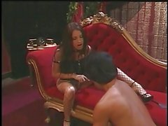 Sexy brunette dominatrix foot fucks guy's cock