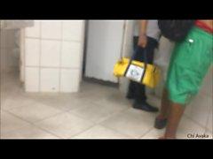 Man masturbating in public bathroom.