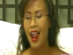 Sexy asian Kim with glasses masturbates