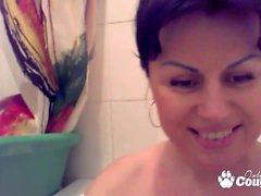 Brunette milf pussy fingering in bathtub