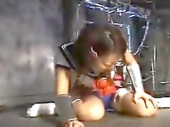 Cute Asian schoolgirl is in the dungeon getting tortured by