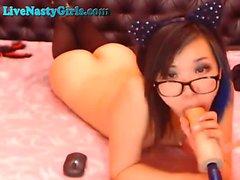 Asian Slut In Glasses Sucks On Her Dildo