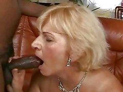 Busty granny fucking with her black lover