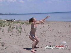Bikini babe learning football then masturbates on beach