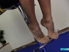 Secretary with perfect legs teases cocks