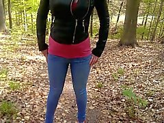 Jenny is pissing her jeans in a forest