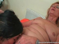 Granny enjoys hot threesome with sexy slut