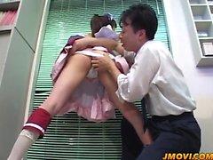 Mari Yamada bent over on the kitchen table and fucked hard