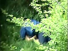 Hidden camera catches man and woman making out in the fores