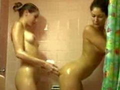 Two tight TnA girls playing in the shower