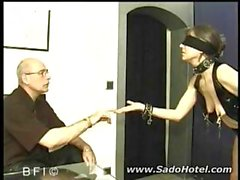 Blindfolded mature brunette gets her saggy tits clamped and gives a blowjob