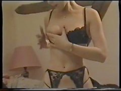 Classic porn with this brunette stripping and getting a DP