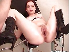Redhead beauty pisses in a bowl