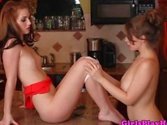 Young lez lovers kitchen counter oral fun