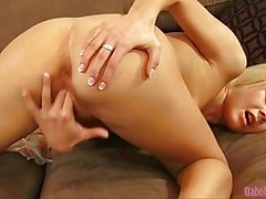 Young blonde slut Cherry Pink dips her digits into her beautiful beaver