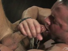 Muscle man Erik Rhodes has some oral fun with Jessie Colter