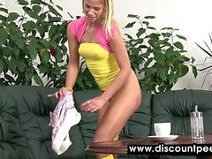 Cute young blonde covers table with piss
