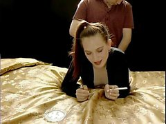 Slender redhead moans with pleasure while getting banged fr