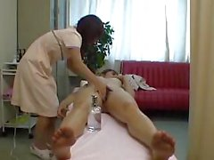 Thin Japanese brunette massages naked lady on bed